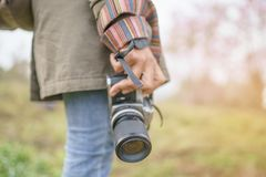 Hand holding camera with beautiful natural. Background Stock Photo