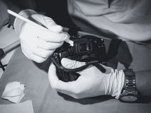 Hand holding Camera cleaning Len and sensor Professional service Royalty Free Stock Photos