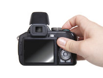 Hand holding camera isolated over white Royalty Free Stock Photos