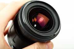 Hand holding camera lens. Closeup of camera lens in hand Royalty Free Stock Image