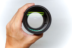 Hand holding camera lens. Top view of a hand holding camera lens converter Royalty Free Stock Photo