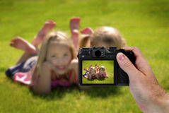 Hand Holding Camera Photograph of Cute Little Girls Stock Photo