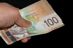 Hand Holding Canadian Bills Stock Photography