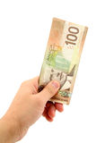 Hand holding canadian dollars Stock Image