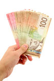 Hand holding canadian dollars Stock Images