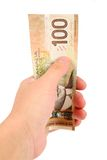 Hand holding canadian dollars Royalty Free Stock Photo