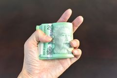 Hand Holding Canadian Dollars Currency royalty free stock photos