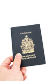 Hand holding Canadian passport Stock Photos