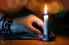 hand holding candle in the dark night bokeh Stock Photos