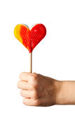 Hand holding candy heart Stock Photography