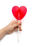 Hand holding candy heart Stock Photo