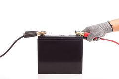 Hand holding car battery jump start isolated on white background Stock Photo