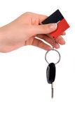 Hand holding car key. Isolated on white background Stock Photography
