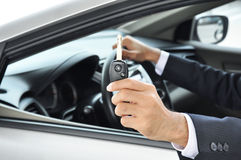 Hand holding a car key - car sale & rental busines Stock Photo