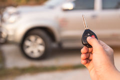 Hand holding car key Stock Images
