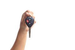 Hand holding car key Royalty Free Stock Photos