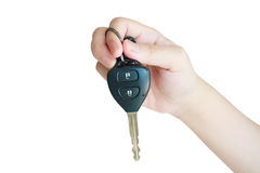 Hand holding car key isolated on white background Royalty Free Stock Images