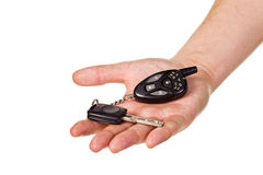 Hand holding car key and remote entry fob Stock Image