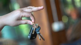 Hand Holding A Car Key Ring royalty free stock image