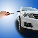 Hand holding a car keys. With a car on blue background stock images