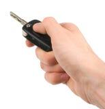 Hand holding car keys isolated Royalty Free Stock Photo