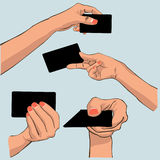 Hand holding card Stock Images