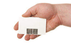 Hand holding card with bar-code Stock Photography
