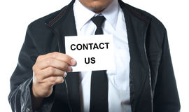 Hand holding card contact us. Business man holding card contact us Stock Images