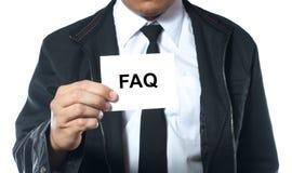 Hand holding card FAQ Stock Photo