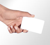 Hand holding card. Isolated on gradient background Stock Images