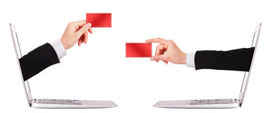 Hand holding card with laptop Stock Photo