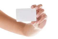 Hand holding card. Manicured woman hand holding blank card isolated on white background Stock Images