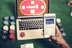Hand holding card playing online gambling Royalty Free Stock Photo