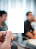 Hand holding card in the serious meeting Stock Image