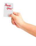 Hand holding card with the word thank you. Isolated on white background Stock Photos