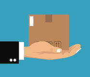 Hand holding cardboard box delivery cargo Royalty Free Stock Image