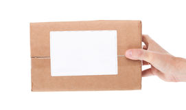 Hand holding cardboard mail box isolated on a White background Royalty Free Stock Images