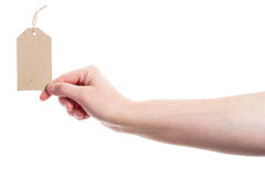 Hand holding cardboard tag Royalty Free Stock Images