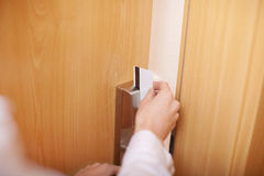 Hand Holding Cardkey And Opening Door Royalty Free Stock Image