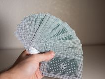 Hand holding cards. First person point of view royalty free stock image