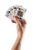 Hand Holding Cards Forming a Straight Stock Photo