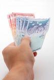 Hand holding Cash. Hand holding Malaysian Ringgit horizontally Royalty Free Stock Photos