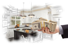 Hand Holding Cash Over Kitchen Design Drawing and Photo Combinat Stock Images