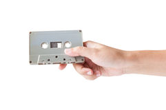 Hand holding cassette tape isolated royalty free stock photo