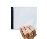Hand holding CD cover. On white background stock photography