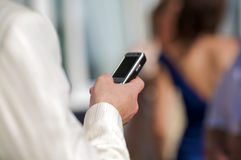 Hand holding a cell phone Royalty Free Stock Photography