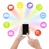 Hand holding cell phone with application icons. Hand using mobile phone with colorful application icons stock illustration