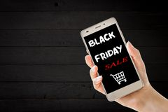 Hand holding cellphone with black friday text stock photos