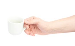 Hand holding ceramic coffee cup Royalty Free Stock Images