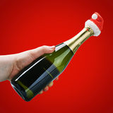 Hand holding a champagne bottle Royalty Free Stock Image